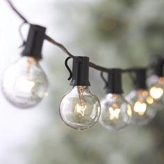 Globe String Lights | Crate  Barrel (but I want to find solar ones, so I don't have to plug them in)