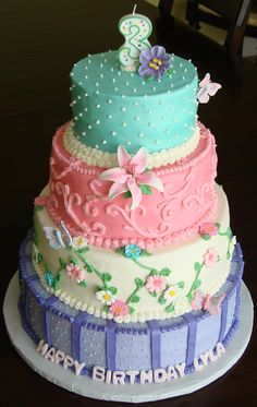 Chic Celebration - 4 tier buttercream cake with fondant and gumpaste flowers and butterflies