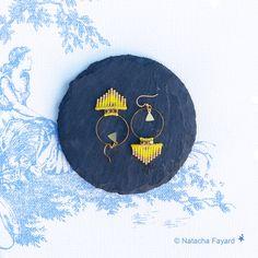 Miyuki delica & micro macrame weaving earrings / hoops. Arrow head / triangle shape. 6 colors available.   © Natacha Fayard   #miyuki #delica #earrings #hoops #arrow #triangle #macrame #micromacrame #turquoise #blue #linen #yellow #red #mint #peach
