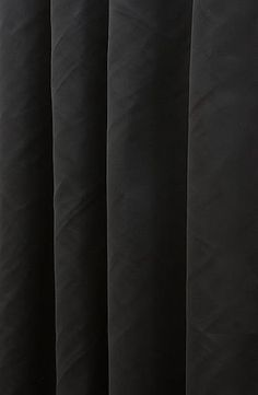 Asina Noir Made to Measure Curtains, from £111 per pair or £14 per metre.