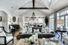 Love all the gray & white tones in the space that make it cozy. Love the beam and light fixture too!