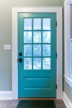 12-pane door with great hardware. Makes a good contrast with the white moldings.