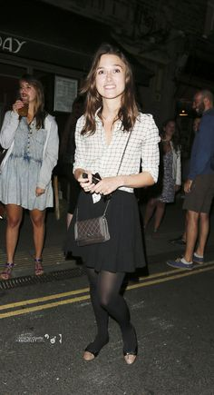 Keira Knightley in lovely black tights.