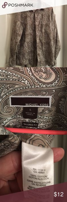 Michael Kors size L men's button down Great button down from Michael Kors. Good shape & free of rips or stains. 100% cotton. Missing one button on one arm. Easy fix!! Bundling is fun; check out my other items! No price talk in comments. No trades or holds. Michael Kors Shirts Dress Shirts