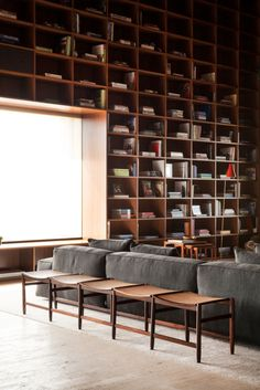 {Former Friday Feature, Studio headed by Marcio Kogan, designs this penthouse with a dramatic double-story library, and treated the internal surfaces as continuous covering them in singular. Timber Panelling, Timber Cladding, Contemporary Architecture, Interior Architecture, Interior Design, Design Design, Foyers, Floor To Ceiling Bookshelves, Studio Mk27