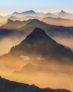 Sunrise flight over a smoke filled Glacier National Park, Montana. Many parts of the Rocky Mountains had record low snow falls in 2018,…