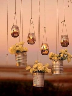 21 DIY Outdoor & Hanging Decor Ideas Suspend these DIY Hanging Flower Votives to decorate your wedding