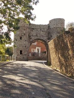 This is Strand Gate, the main gate to the town of Winchelsea in East Sussex, England. It was built in 1300 and would have had two gates and a pair of portcullises to protect the town from invasion from the harbour down Strand Hill, there are two other gates to the town which are still standing by B Lowe