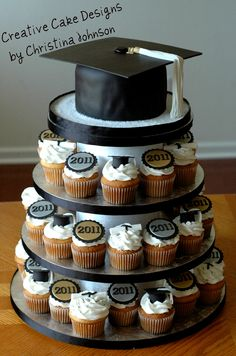 https://flic.kr/p/9QXVuY | Graduation Cupcake Tower | For Grad's from multiple schools. I went with generic colors and LOVE how it turned out! I had complete control over the entire design. All cupcakes toppers are hand made and completely edible Grad cap on top is Cake and completely edible as well! =)
