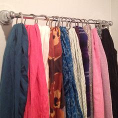 Scarves are finally organized! Purchased small towel bar from Marshall's and hung scarves using shower curtain hooks. Fit perfectly between our bedroom door and closet!