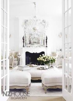 white room, french doors, love the enormous ottomon
