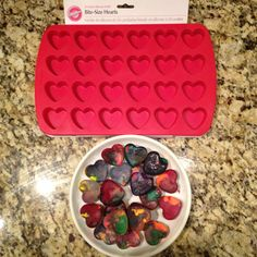 How to make heart shaped crayons: *this is a Wilton 24 cavity silicone mold** 1.  Use old or new crayons 2.  Soak crayons in a bowl with hot water & Dawn soap.  3. Take paper off crayons 4.  Dry them on a paper towel and lay them in color order 5.  If you have kids (or don't, lol) put the crayons in ziplock bags and let them stomp on them to break them up. 6.  Put the crayons in to the mold to the top. 7.  Set oven for 250 degrees  8.  After you fill them all up, put drops of your favorite s...