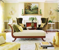 Living room:  linen print draperies; yellow cotton velvet on a pair of low-slung tufted chairs;  green velvet on the front of a '50s-style wing chair duo in front of the fireplace.