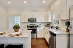 "Traditional Kitchen with European 6"" Bar Pull, Andino White Granite Countertop, Craftsman Panel Cabinet Door"