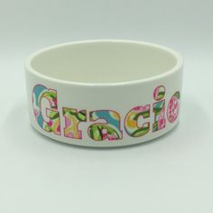 Pet Bowl  Check out our personalized pet bowl in a Lilly inspired print! This pet bowl features your pets name printed with pattern filled letters. A custom pet bowl is the perfect pet accessory and makes a great personalized gift for a pet owner. Details about the bowls:  * Made of ceramic * Made to order * One side printed and personalized * Custom printing process will permanently heat press design into bowl * Design will not fade, peel or wash off  *Dishwasher safe (top rack)  Two sizes…