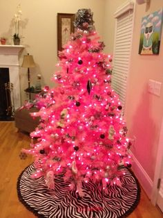 Zebra stripes tree skirt paired with our pink tree for a chic holiday ensemble.