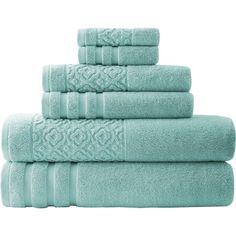 Refresh the master bath or powder room with this elegant towel set, woven of cotton and showcasing an embossed scrolling motif.