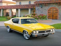 AUT 22 01 - 1968 Chevrolet Chevelle SS 396 Yellow Front View On Pavement By House - Kimballstock Muscle Cars Vintage, Old Muscle Cars, Chevy Muscle Cars, American Muscle Cars, Vintage Cars, Chevrolet Chevelle, 1968 Chevelle Ss, Chevy Ss, Chevy Girl
