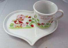 http://www.ebay.com/itm/Vintage-1983-Strawberry-Shortcake-porcelain-snack-set-tray-cup/381725547639?_trksid=p2047675.c100010.m2109&_trkparms=aid%3D555012%26algo%3DPW.MBE%26ao%3D2%26asc%3D20131231084308%26meid%3D1235dcc2f52d419391b7d38128d8610c%26pid%3D100010%26rk%3D6%26rkt%3D24%26sd%3D272341579162