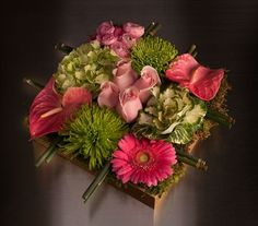 Bento-Box style arrangement is designed with - hydrangea, roses, spider mums, anthurium, kale and ranunculus and all arranged in a gold narrow square box. Perfect for the dining table or in any room of the house of office. This arrangement is stylish!