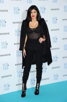 Wearing an all-black ensemble an event in London.   - ELLE.com