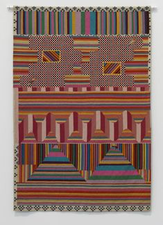 Artwork page for 'Tapestry', Sir Eduardo Paolozzi, 1966 on display at Tate Modern. This tapestry was woven from a collage by Paolozzi, an artist who worked across sculpture, print-making and film, incorporating imagery from popular culture and forms from industrial machinery.