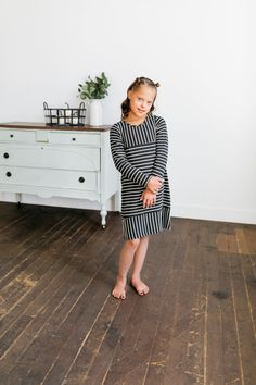 Navy and white stripes are our favorite and we know your little girl will love them too. This dress is perfect for playing, school, and special occasions. Toddler Fall Outfits Girl, Girls Fall Outfits, Winter Outfits, Stylish Baby Girls, Fashionable Kids, Girls Fall Fashion, Family Picture Outfits, How To Look Skinnier, Clothing Sites