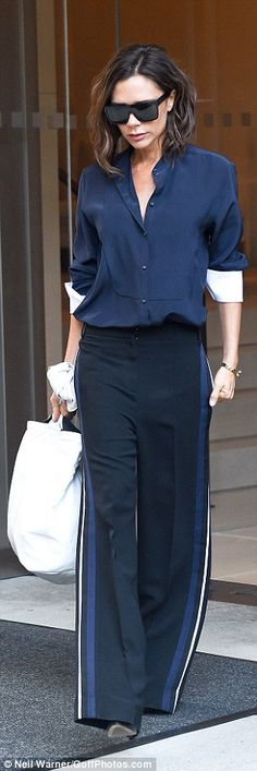 If it aint broke! Sticking to her trusty style combination of a shirt and trousers, the 42-year-old designer oozed glamour as she stepped out in the city