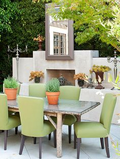 A tranquil color palette of sage green and beige makes this patio a relaxing and peaceful space. For more causal porch and patio dining ideas, look here: http://www.bhg.com/home-improvement/porch/outdoor-rooms/casual-porch-dining/?socsrc=bhgpin042015calmcoolporch&page=10