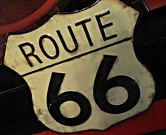 Route 66 sign at vintage hot rod themed boys car party ideas sweets table