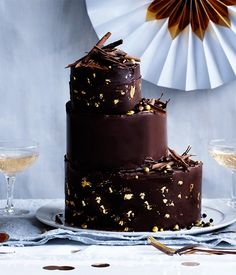 One of our 50th birthday issue cover stars, naturally this hazelnut-chocolate cake is a showstopper. We've glammed it up by encasing each layer in a glossy chocolate collar (see note) with flecks of edible gold leaf, but by all means leave this out for a simpler effect.