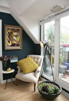 dark blue wall with contrasting white.  The Look for Less: Isabelle's Reading Nook on a Budget
