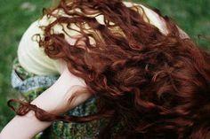 dark red curly hair