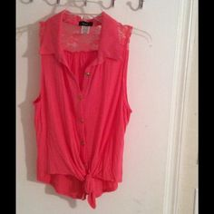 Pink top Pink top buttons up front ties at the bottom. Back has lace gently used. Tag says large fits like a medium. Tops Blouses
