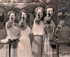 Vintage women with guns.