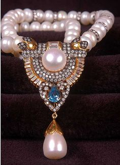 Beautiful juxtaposition of the organic pearls and mineral gems. diamonds gold gems jewelry tear drop