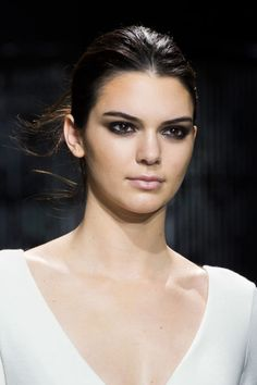"We always love when a sexy smoky eye makes an appearance on the runway. Though sometimes a dramatic eye can be intimidating, this season at Diane von Furstenberg makeup artist Pat McGrath created a diffused look using just black and brown liner that she called a ""smoky eye girls would do at home."""