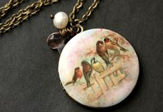 Summer Garden Necklace. Bird Family Locket Necklace. Bird Necklace. Bronze Necklace with Pink Teardrop and Fresh Water Pearl. by StumblingOnSainthood from Stumbling On Sainthood. Find it now at http://ift.tt/1NNIsUc!