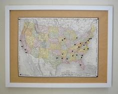 mounted map on a cork board with map pins for places we've traveled together. you can add new colors for when the kids come. #YoungHouseLove