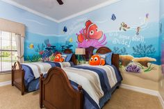"Kids can ""just keep swimming..."" with their favorite ""Finding Nemo"" pals in this twin bedroom located in 2802 Spinning Silk, just 3 miles from Disney!"