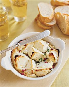 Goat Cheese Appetiser: Break 8 to 12 ounces of marinated goat cheese into large chunks, place in an ovenproof dish, and bake at 325 degrees for 15-20 mins until golden brown. Remove from oven, drizzle with olive oil, and garnish with fresh thyme and 1/2 teaspoon whole pink peppercorns.