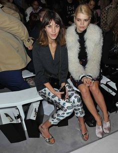 Alexa Chung is wearing printed trousers and a black cardigan to attends the House OF Holland catwalk show during London Fashion Week Autumn/Winter 2012, 18th February 2012.