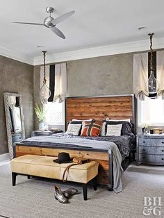 There's something about wooden headboards that give a room an undeniable warmth. Here, mixing a steel frame with handsome knotty boards yields a headboard ripe with industrial edge. Gray bedding blends with the metal frame and provides cool contrast to the warm wood finish. If you're making this frame yourself, don't feel limited by the height of the headboard. Build it tall for an even more dramatic look that could double as an accent wall.