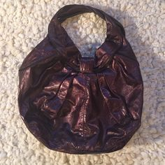 "Kooba wine purple tote handbag hobo style Great bag - wine/purple color with metallic sheen.  Looks brand new!  Inside includes 1 zippered pocket on one side, the other interior side has 2 small open pockets (eg phone size), 1 thin slots for pens and a hook for keys.  Approx 10.5""drop, 19"" across and 11-12"" deep and 3"" wide Kooba Bags Hobos"