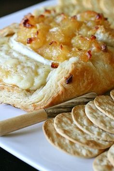 Baked Brie en Croûte with Apple Compote. Might add some pears to the compote when they are in season.