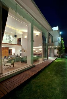 """Mexico City-based studio ARCO Arquitectura Contemporánea has designed the Casa LC project. Completed in 2011, this 7,588 square foot two story residence is located in Mexico City, Mexico. Casa LC by ARCO Arquitectura Contemporánea: """"This house is located inside of a very exclusive residential development in Mexico City that has an excellent golf course. It is situated in one of the areas with more economic growth in the last years, but the design allows maintaining the n..."""