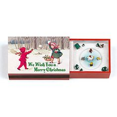 """Matchbox Music Box Merry Christmas. Popular every year! Inspired by the matchbox miniature Christmas scenes made in Germany in the early 1900s, these delightful little music boxes are exquisitely detailed and crafted. Inside, tiny hand-painted figures turn to the tune of a wind-up musical mechanism. Fun for decorating, collecting and giving, each 3¼"""" matchbox (5½"""" long when open) features a different coordinating song and scene. Silent Night, for example, houses a full Nativity Scene…"""