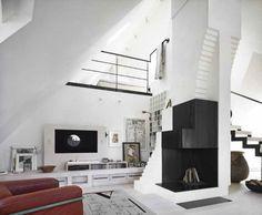 Fireplace at Stockholm penthouse designed by its owner, Swedish artist Carouschka Streijffert.