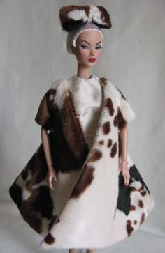 Evening in Montreal Victoire wearing faux fur swing coat and silk sheath dress.