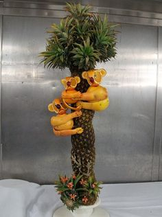 Orange koalas in a pineapple tree